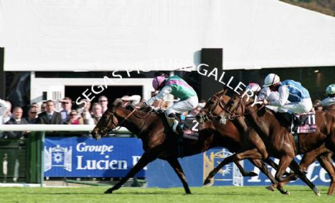 Racehorses Promising Lead with Jockey Ryan Moore and Satwa Queen with Jockey Thierry Thulliez